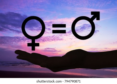 Genders symbols, silhouette of a hand open in the sunset, gender equity concept