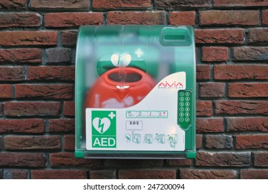 GENEMUIDEN, THE NETHERLANDS, CIRCA JANUARY 2015 - Automatic External Defibrillator in a box at a wall.