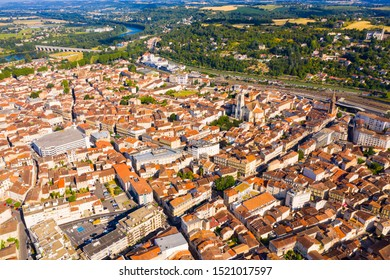 General aerial view of Agen summer cityscape on bank of Garonne river on sunny day, France