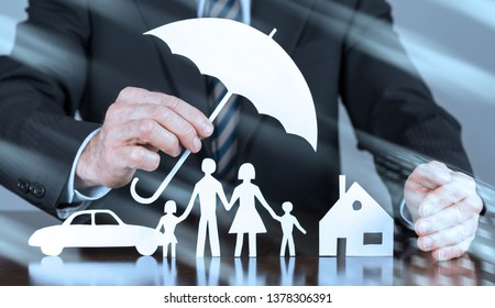 General agent protecting a family, a house and a car with his hands, light effect