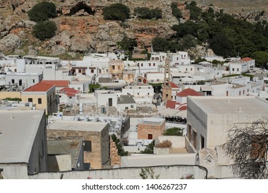 General beautiful views from architectural traditional buildings and decorated houses in Lindos village. Scenic view of Greek house in Lindos village. Lindos-Rhodes Island/Turkey 05/17/2019
