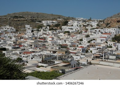 General beautiful views from architectural traditional buildings and decorated houses in Lindos village. Scenic view of Greek house in Lindos village. Lindos-Rhodes Island/Greece 05/17/2019