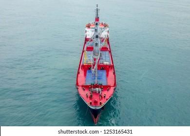 General cargo ship at sea - Aerial image.