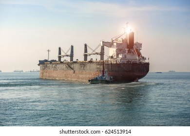 general cargo vessel ship sailing departure from the sea port