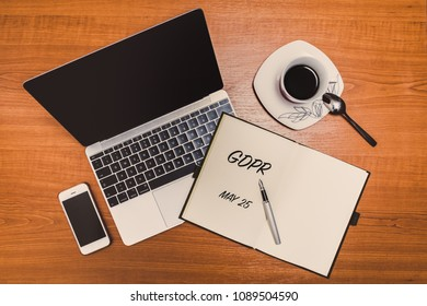 General Data Protection Regulation (GDPR) title on a note with notebook and coffee