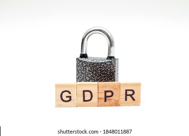 General Data Protection Regulation (GDPR) made from wooden blocks and metal Padlock on white background