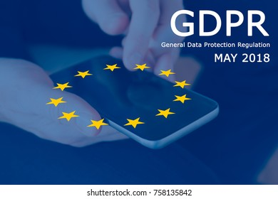 General Data Protection Regulation (GDPR) - European Flag, hands and a smartphone.