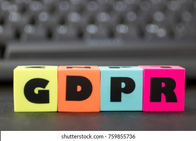 General Data Protection Regulation - letters spelling GDPR, keyboard in background.