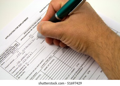 A general employment application being filled out.