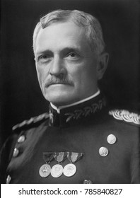 General John Pershing in uniform with medals, 1910-1920. After graduating from West Point in 1886, he led Buffalo Soldiers in campaigns against the Apaches. His association with African American soldi
