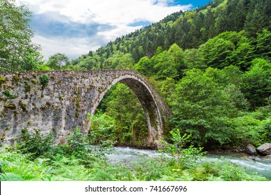 General landscape view of historical high stone bridges on Firtina river in Rize Camlihemsin area on cloudy sky background.