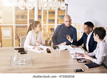 The general manager of a large firm busy constructively criticizing his firms upper management to try and improve the company's net profit in the following year.