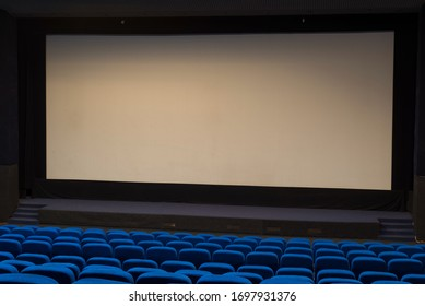 General plan of empty blue cinema seats. Deserted movie theater. Watching the movie. New movie.