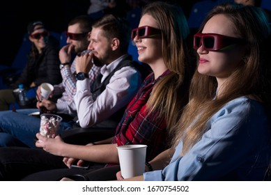 general plan of young people of different sexes, from nineteen to thirty years old, sitting on the seats in the cinema, watching a movie with glasses for 3D. Generation Z, Generation Y, Millennials.