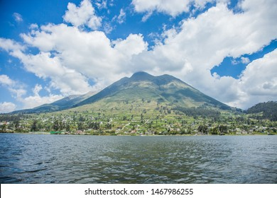 General plane of a landscape with a lake, a large mountain and a town called San Pablo, taken in Ecuador in the city of Otavalo on Lake San Pablo.