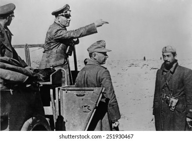 General Rommel standing in jeep in the North African desert, Feb. 1-10, 1942. Rommel's German-Italian forces were resupplied with tanks and fuel in January 1942. He soon captured Benghazi, Libya.