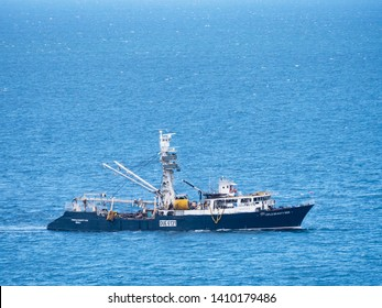 General Santos City, The Philippines - May 22, 2019: Ocean going tuna vessel with the characteristic watchtower off the coast of General Santos City, the tuna capital of the Philippines.