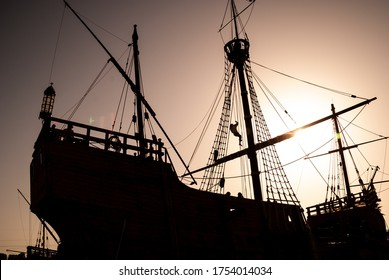 general shot, in silhouette, of an old caravel (ship), on a sunny day