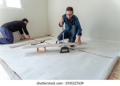 general shot of two men working on the installation of a laminate wood floor