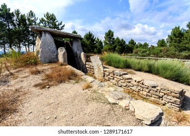 General view of the Dolmen of Cortico showing the chamber, corridor and the fence on the outer limits of the original mound, in Fornos de Algodres, Portugal