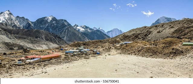 General view of the Gorak Shep village and of Khumbu glacier from slope of Kala Patthar on a sunny day - Everest region, Nepal