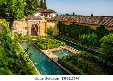 Generalife gardens with fountains in Alhambra,Granada,Spain