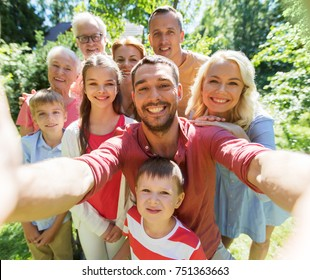 generation and people concept - happy family taking selfie in summer garden