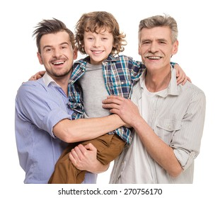 Generation portrait. Grandfather, father and son looking at camera, isolated a white background.