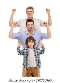 Generation portrait. Power. Grandfather, father and son isolated a white background.