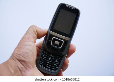 Generation of this Mobile phone, 2G. Mobile phone in hand.