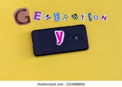 """Generation Y"" formed with cut letters and a smarthphone. Concept of the revolutionary generation of digital natives also called Millennial."