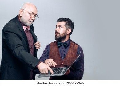 Generations. Age education. E-learning: son and senior father. Explains how to use a laptop. Senior mister and young men in home school. Family of different age generations
