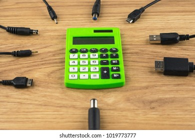 generations of technology gap: old dusty calculator and lots of plugs and charger that can't connect to it, with perspective