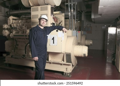 A generator  in a hospital with a repair men.