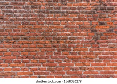 generic background of stone textured and colored orange red and dirty flushed ancient brick factory wall