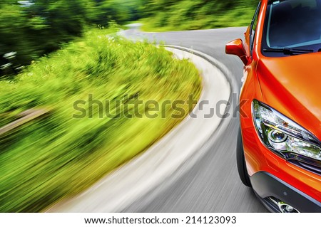 Generic car driving on a winding road