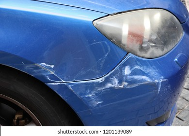 Generic car with scratched paint on front wing. Minor accident result - fender bender.