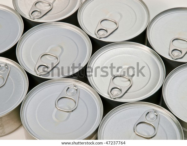Generic cat food cans.  Photograph looking down at ten can tops,and pull tabs. Backgorund and texture