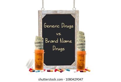 Generic Drugs vs. Brand Name Drugs Blackboard sign behind prescription bottles with twenty dollar bills and medicine white background