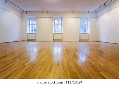 Generic empty exposition room with wooden floor- lots of copy space