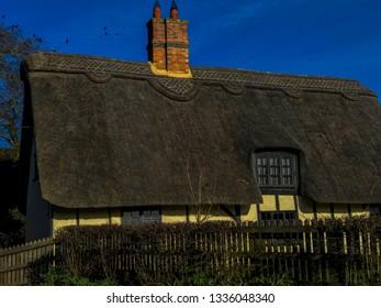 generic english cottage in village sunshine