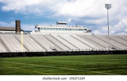 Generic football stadium with blue sky