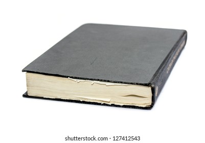 Generic hard bound black book with blank cover, isolated on white background.