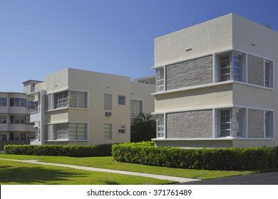 Generic lowrise apartment building with garden