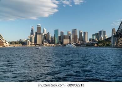 generic modern cityscape with water reflection in daytime blue sky, Sydney city with landmark skyscraper skyline