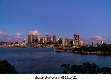 generic modern cityscape with water reflection in dawn sunset, harbor city with downtown skyscraper in business district Sydney