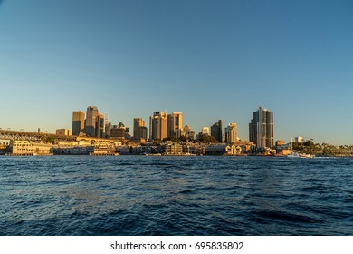 generic modern cityscape with water reflection in sunset, harbor city with downtown skyscraper in business district Sydney