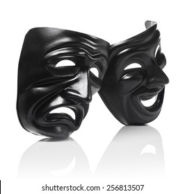 Generic plastic masks as theatrical symbols isolated on white with reflection