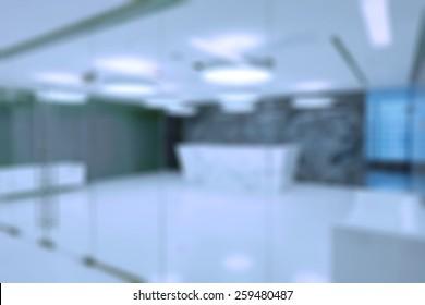 Generic reception in modern business centre building blur background