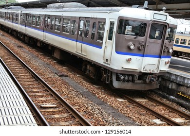 Generic regional commuter train in Chugoku region, Japan. Contemporary railroad locomotive.